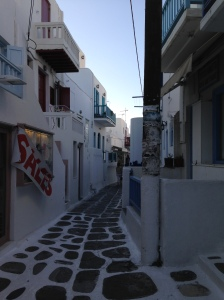 iphone_iphone5c_wallpaper_mykonos_greece_sale_sign_honeymoon_market_narrow_street